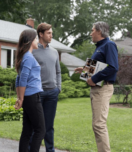 Home inspector meeting with a couple selling their home